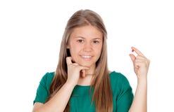 相当有药片的女孩 免版税库存图片