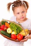 相当有蔬菜和水果的小女孩 免版税图库摄影