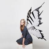 相当有蝴蝶翼的青少年的女孩 库存图片
