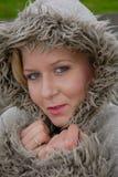 相当温暖外套的女性 免版税图库摄影