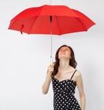 相当礼服的少妇有开放伞的 图库摄影