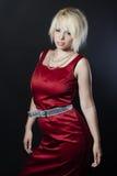相当红色礼服的少妇 免版税图库摄影