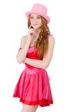 相当被隔绝的微型桃红色礼服的年轻巫术师  免版税库存照片