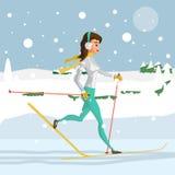 相当跑在森林的越野滑雪的少妇 库存图片