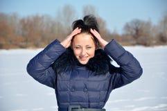 相当雪的性感的女孩 免版税图库摄影