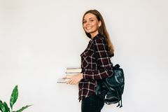 相当青少年镀金学校或学院的学生有堆的书教育 免版税库存图片