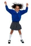 相当非洲学校女孩跳舞正起劲 免版税库存图片