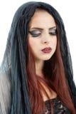 相当年轻红头发人巫婆,被隔绝反对白色背景 图库摄影