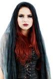 相当年轻红头发人巫婆 免版税图库摄影