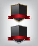 盾金子和银与红色丝带 图库摄影