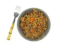 在碗上面的菜肉饭与叉子 库存图片