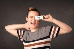 看与手拉的眼睛纸的傻的年轻人 库存图片