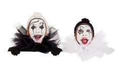 看在框架之上的二个滑稽的小丑 库存图片