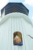 看塔的窗口的女孩 免版税库存照片