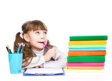 看对边的体贴的女小学生和上升 查出在白色 免版税库存图片