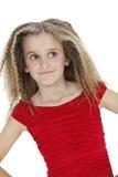 看斜向一边在白色背景的微笑的女孩正面图 免版税库存照片