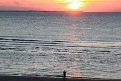 看日落,阿默兰岛,荷兰海岛  库存图片
