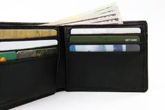看板卡兑现被充塞的钱包 库存照片