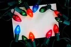 看板卡圣诞灯附注 免版税库存照片