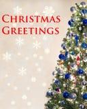 看板卡圣诞节问候在上写字快活 免版税库存照片