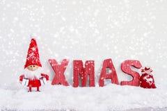 看板卡圣诞节问候 圣诞老人与圣诞节d的地精背景 免版税库存照片