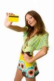 看板卡赊帐查出的俏丽的妇女 库存照片