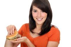 看汉堡包的女孩 库存照片