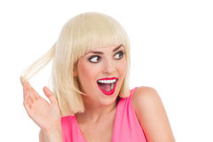 看激动的美丽的白肤金发的女孩  免版税库存照片