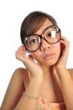 看起来亚裔中国的女孩困惑 库存照片