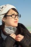 看起来亚裔美丽的方式的女孩正确 库存照片