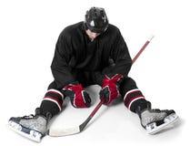 看起来冰球的球员失望 免版税库存图片