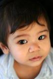 看起来害羞的婴孩 图库摄影