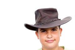 看起来微笑的年轻人的照相机牛仔 库存照片