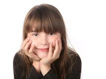 看起来微笑的浏览器的柔和女孩 免版税库存图片