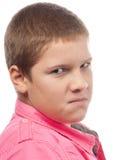 看起来恼怒的男孩的怨恨少年 免版税图库摄影