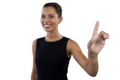 看起来愉快的女实业家去,当接触无形的接口时 库存照片