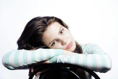 看起来的十几岁的女孩担心隔绝在白色背景 免版税库存照片