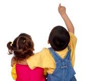看起来的孩子指向  免版税库存照片