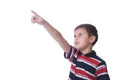 看起来的男孩指向  免版税库存图片