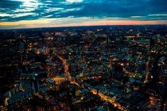 看起来西部伦敦眼,滑铁卢,巴特锡的伦敦夜 库存图片