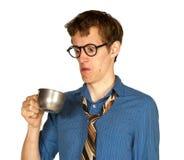 看起来里面金属杯子的人 免版税图库摄影