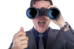 看通过双筒望远镜的商人 库存照片