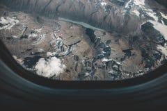 看飞机窗口,概念photoshop的 免版税库存照片