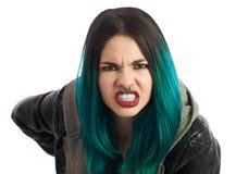 看直接照相机的恼怒的被刺穿的女孩 库存图片