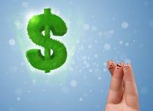 看绿色叶子美元的符号的愉快的兴高采烈的手指 库存图片