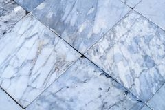 真正的大理石铺磁砖无缝的地板纹理,白色石瓦片patte 免版税图库摄影