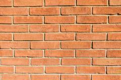 真正的橙红砖墙石工背景 免版税库存图片