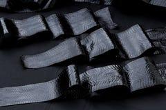 真正眼镜蛇snakeskin皮革,蛇皮,纹理,动物,在黑背景的爬行动物 免版税库存照片