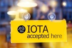 真正金钱IOTA cryptocurrency - Iota MIOTA货币accep 免版税库存图片