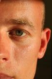 眼睛表面理平头的人 库存图片